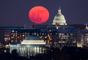 A so-called 'supermoon' rises behind the US Capitol and the Jefferson Memorial (bottom), in Washington, DC, viewed from Arlington, Virginia, US.