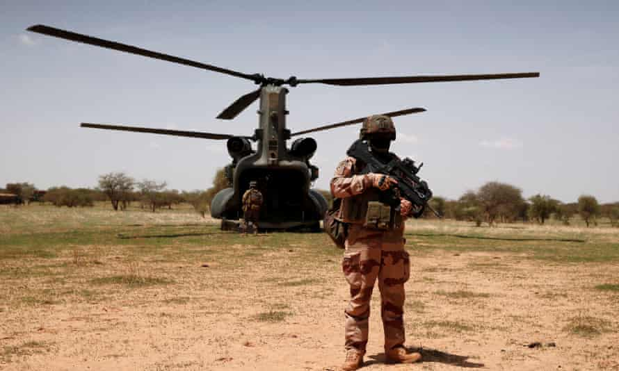 A French soldier in west Africa. Islamist insurgents were blamed for the deaths of 20 victims in Burkina Faso on Friday.