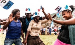 Supporters of the governing Rwanda Patriotic Front dance during a campaign rally in Kigali.