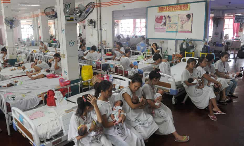 Mothers tend to their newborn babies at a maternity ward at the Dr Jose Fabella Hospital in Manila.