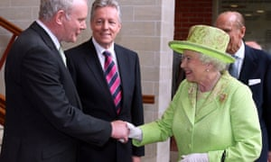 Martin McGuinness shaking hands with the Queen, with first minister Peter Robinson, centre, in Belfast in 2012