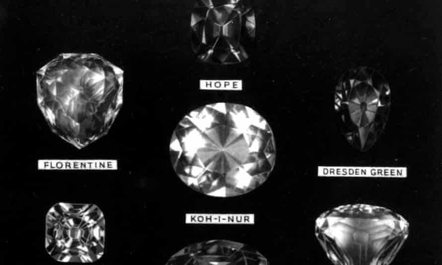 The 106-carat Koh-i-noor diamond, centre, is pictured among other famous stones.