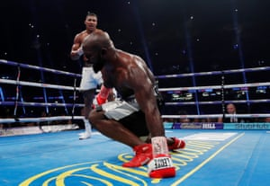 Carlos Takam has a breather after being knocked down by Anthony Joshua.