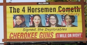 A billboard erected by the store Cherokee Guns.