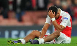 Alex Oxlade-Chamberlain looks dejected after the final whistle.