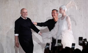Christian Lacroix (l) with Dries Van Noten with female model dressed in white to their right