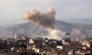 Smoke rises after Syrian regime aircraft carried out airstrikes on a town in the eastern Ghouta region near Damascus on 5 March.