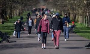 People walk in Greenwich Park in London on Sunday