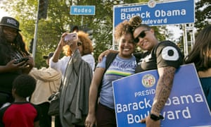 Midori Bastien, second from right, and Jameela Hammond have their photo taken with the newly unveiled Obama Boulevard sign in Los Angeles on Saturday.