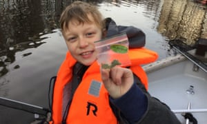 Gus Krohn having fished out 'Dr Grinspoon' from the canals of Amsterdam, a small plastic bag of weed.