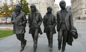 Paul, George, Ringo and John on the waterfront in Liverpool