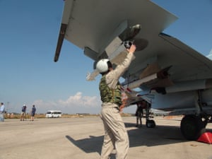 A Russian air force technician checks a Sukhoi Su-30 jet fighter at the Hmeimim airbase in the Syrian province of Latakia.