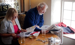 Retired couple reading the papers