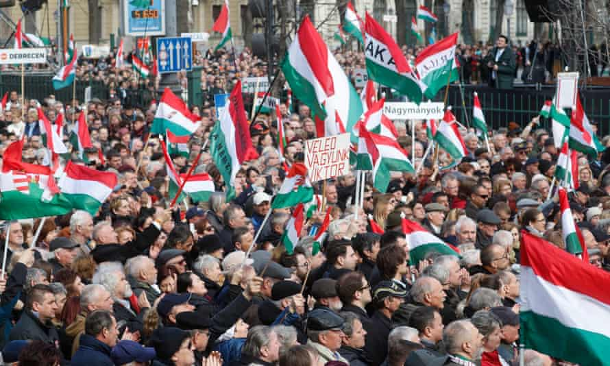 People gather to watch Hungary's populist prime minister Viktor Orban deliver a speech in Budapest. The uneven progress from communism to capitalism is believed to have sowed the seeds of populism that is currently strengthening in central Europe.