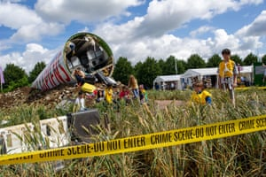 Garden Designer Felicity O'Rourke, who qualified earlier this year, in her show garden Extinction in and around the fuselage of a crashed aircraft