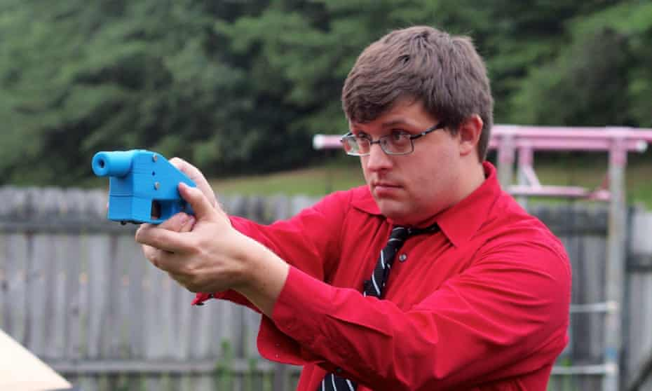 A software engineer aims a 3D-printed gun. Officials fear the weapons will allow users to work around gun laws.