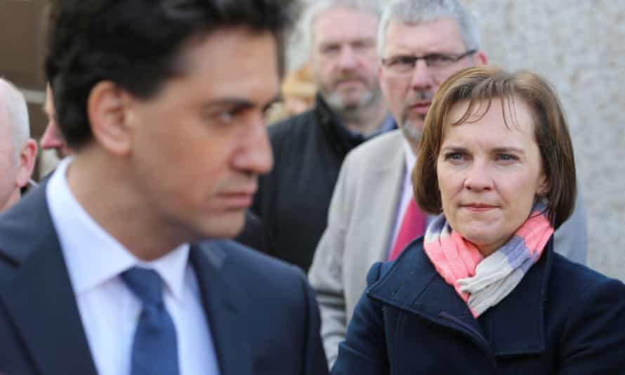 Ed Miliband with his wife, Justine, looking on