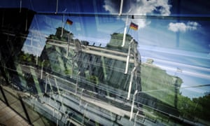 The Reichstag reflected in a Berlin window.