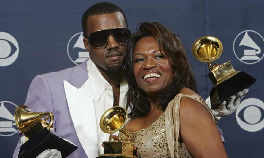 Kanye West and his mother Donda, hold his three awards backstage at the 48th Grammy awards