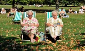 Elderly women enjoy a read on deck chairs in London's Hyde Park.