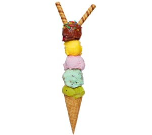 Waffle cone with five balls of ice-cream on top and two biscuit sticks on top