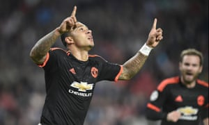 Depay celebrates after scoring a sublime opening goal.