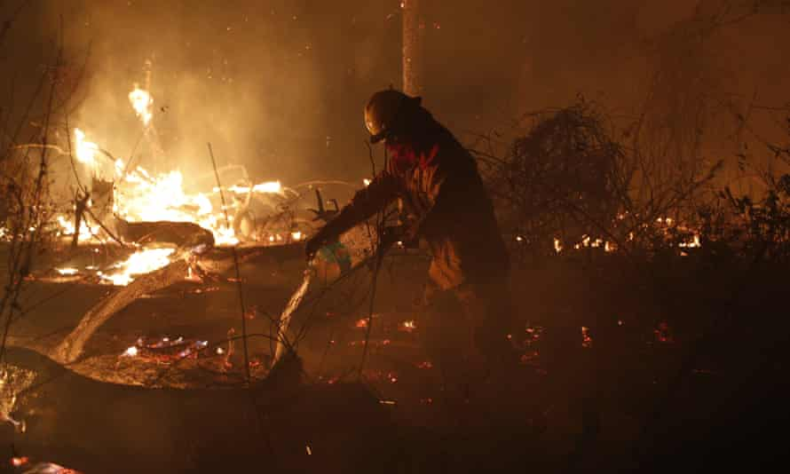 A marine works to put out a fire in the Chiquitania Forest in Santa Rosa de Tucabaca, on the outskirts of Robore, Bolivia in August.