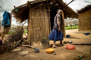 A child outside a home in the village