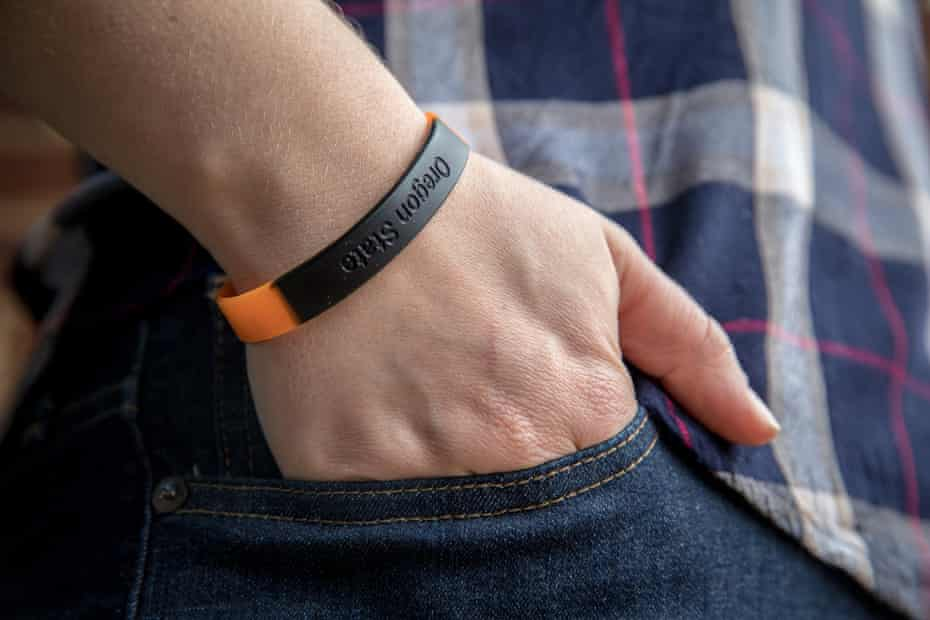 Emily Holden, the environment reporter for The Guardian US, has been wearing a silicone band developed by Oregon State University to measure chemicals from the surrounding environment over time. The wristbands can absorb volatile and semi-volatile compounds directly from the air and enable researchers to correlate location with air pollutants.