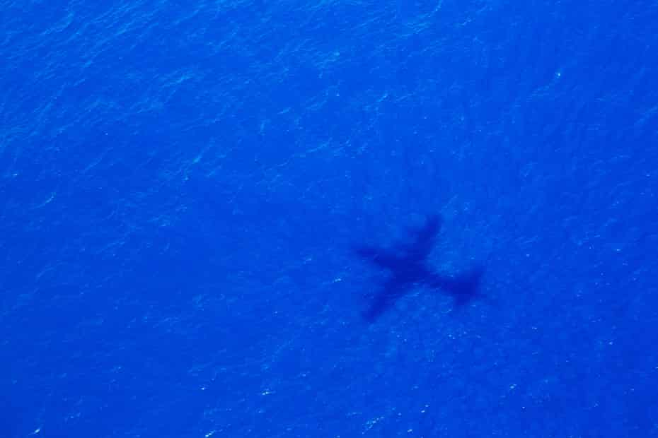 The shadow of a search plane scouring the Indian Ocean for debris in April 2014
