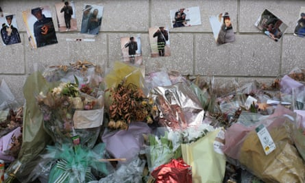 Floral tributes to Kelvin Odunuyi, outside a cinema in Wood Green, north London