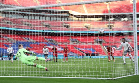 Marcus Rashford scores from the spot to equalise for England at an empty Wembley