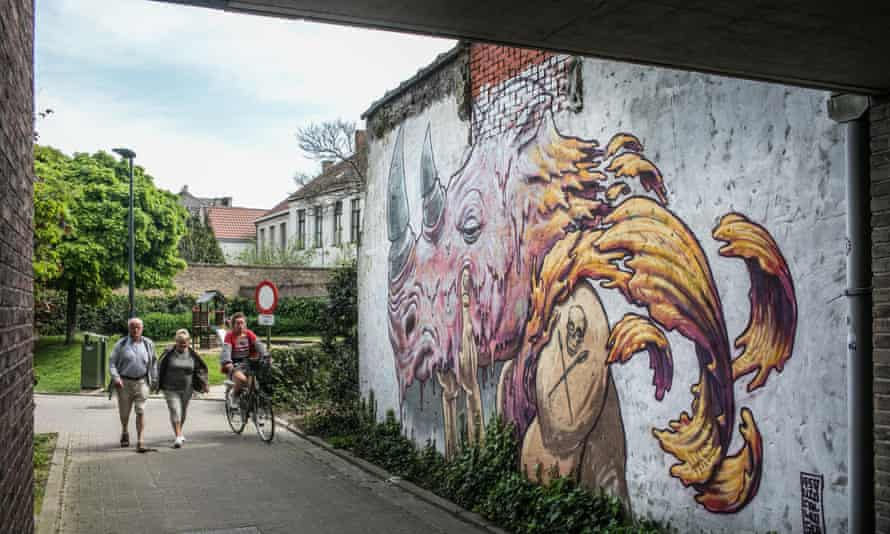 Written on the wall: pedestrians, bikes and street art all give to give Ghent a modern edge.