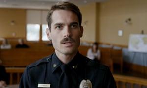 Jim Cummings as struggling police officer Jim Arnaud in Thunder Road.