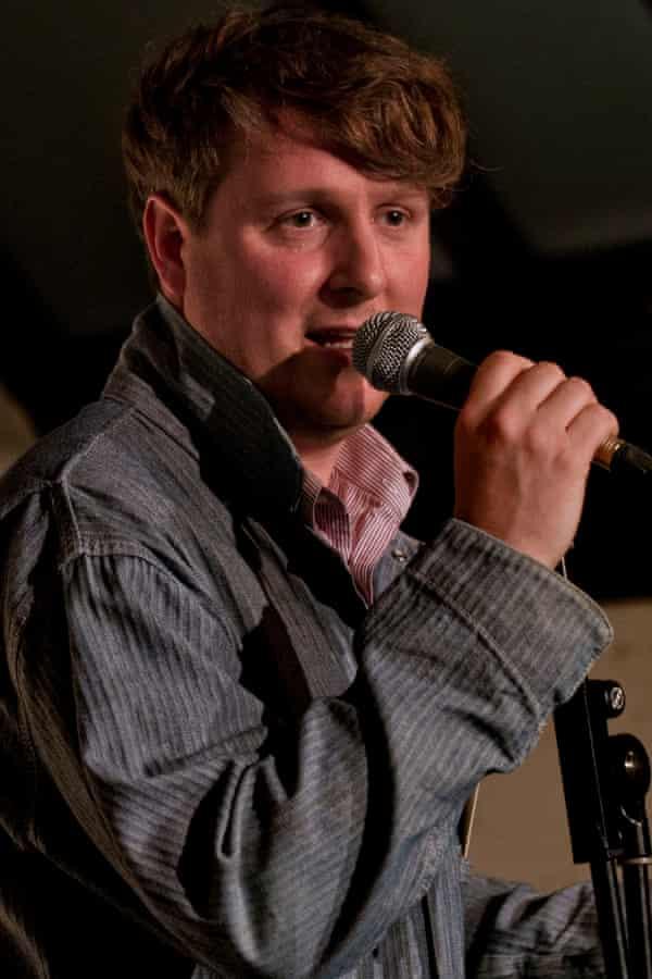 Tim Key on stage.