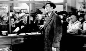 James Stewart attends to the banking needs of the people of Bedford Falls in It's a Wonderful Life.