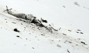 The wreckage of a helicopter lies in the snow after crashing in Campo Felice ski area in Italy