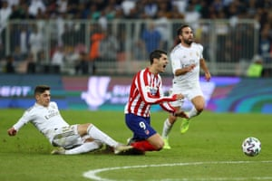 Federico Valverde of Real Madrid tackles Alvaro Morata of Atletico Madrid which results in the red card being shown.