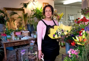 Petrena Campbell at The Flower House holding a bouquet