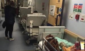Trolley queue in a hospital corridor
