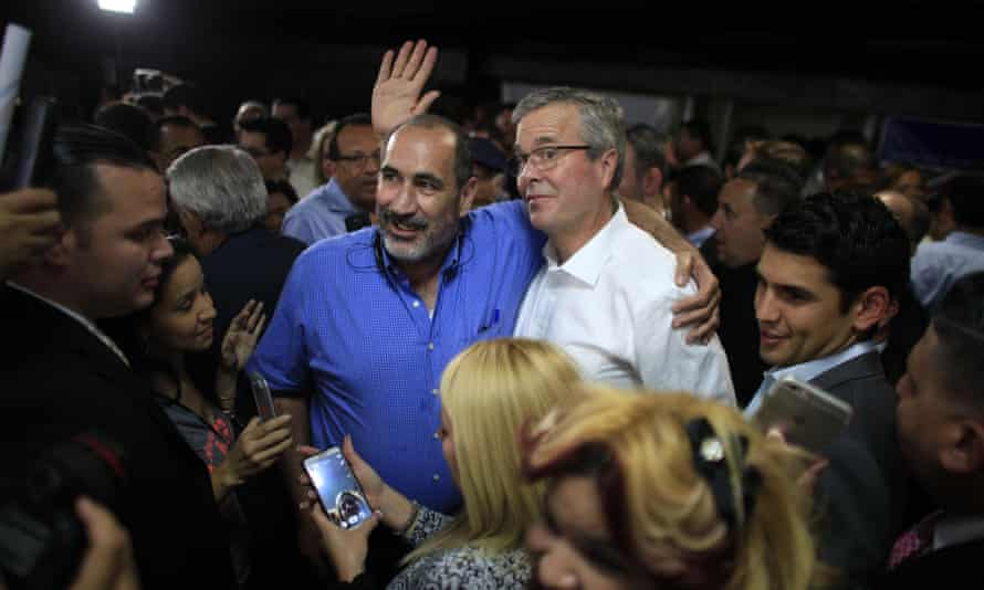 The former Florida governor Jeb Bush poses for a pictures with supporters after a town hall meeting in Bayamon, Puerto Rico.