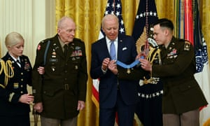 Biden with Ralph Puckett in the East Room of the White House on Friday.