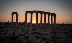 A sun rises over the ruins in Palmira, Syria