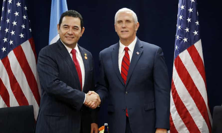 Jimmy Morales and Mike Pence at a summit in Miami last week. Several members of Barnes & Thornburg have worked for the vice-president in the past.