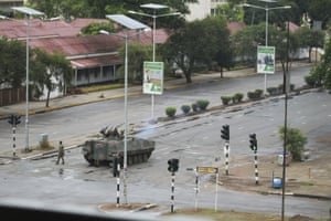 "A military tank is seen with armed soldiers on the road leading to President Robert Mugabe's office in Harare, Wednesday, Nov. 15, 2017. Overnight, at least three explosions were heard in the capital, Harare, and military vehicles were seen in the streets. On Monday, the army commander had threatened to ""step in"" to calm political tensions over the 93-year-old Mugabe's possible successor. (AP Photo/Tsvangirayi Mukwazhi)"