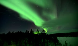 A shock of green over a forest in Murmansk, Russia