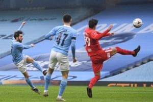 Manchester City's Portuguese midfielder Bernardo Silva (L) scores the opening goal.