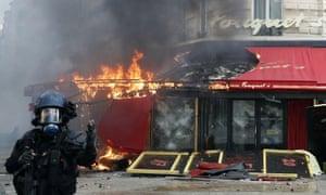 The Fouquet's restaurant on fire during a gilets jaunes protest, Paris, 16 March