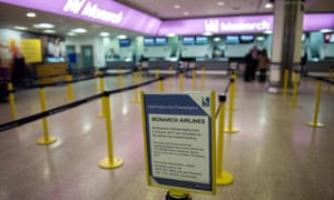 A sign reporting Monarch has ceased trading at the company's check-in area at Birmingham airport.