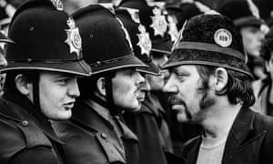 A striking miner faces a line of police at the Orgreave coking plant during the miners' strike in June 1984.